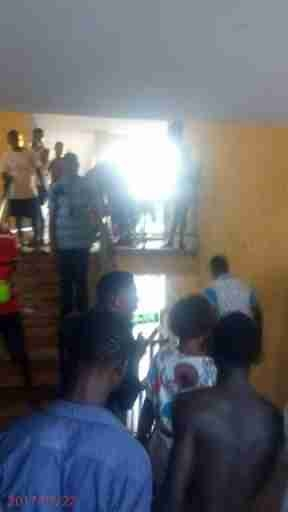 Hilarious As Lady Visits A Guy At His Hostel, Crowd Of Guys Wait Outside To Hail Him (Photos)